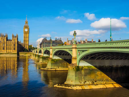 westminster bridge: LONDON, UK - SEPTEMBER 28, 2015: Tourists on Westminster Bridge at the Houses of Parliament aka Westminster Palace (HDR)