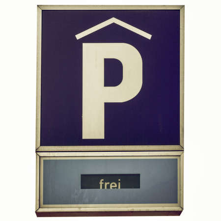 Vintage looking A road sign for a parking area - in German (Deutsch) - isolated over white background Stock Photo