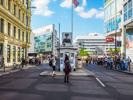 east berlin: BERLIN, GERMANY - CIRCA JUNE 2016: Checkpoint Charlie (aka Checkpoint C) wall crossing point between East Berlin and West Berlin during the Cold War (HDR)