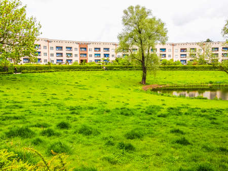 taut: BERLIN, GERMANY - MAY 11, 2014: The Hufeisensiedlung (meaning Horseshoe housing estate) aka Grosssiedlung Britz designed by Bruno Taut and Martin Wagner in 1925 is a masterpiece of early modernism (HDR)
