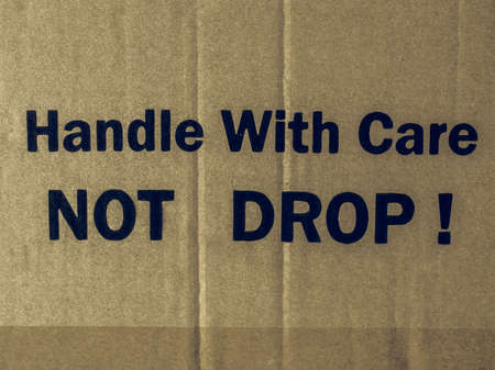 handle with care: Vintage looking Fragile Handle with Care Do not drop label on a corrugated cardboard box Stock Photo