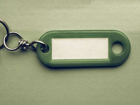 key ring: Vintage looking Green key ring with blank paper label with copy space