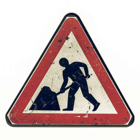 white work: Vintage looking Road works sign for construction works in street - isolated over white background