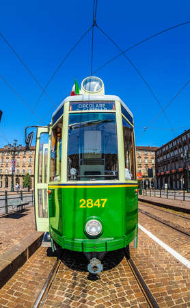 streetcar: TURIN, ITALY - CIRCA SEPTEMBER, 2015: A vintage historical green tramway seen with fisheye lens (HDR) Editorial