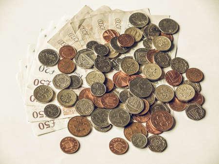 uk money: Vintage looking British Pounds Stock Photo
