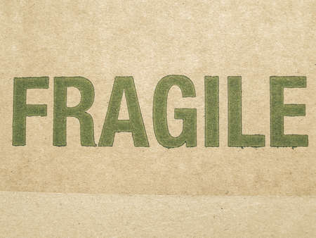cardboard texture: Vintage looking Fragile written on corrugated cardboard box picture