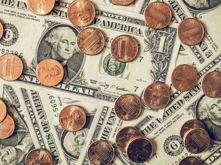 see the usa: Vintage looking One cent coins and One Dollar banknotes  currency of the United States useful as a background Stock Photo
