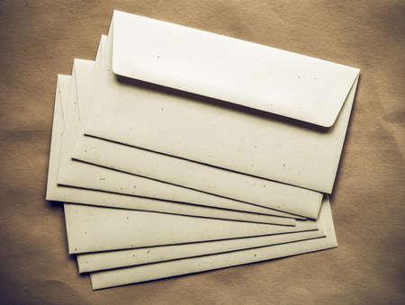 sobres para carta: Vintage sobres de la letra futuro para el franqueo electrónico sobre fondo de papel de color naranja