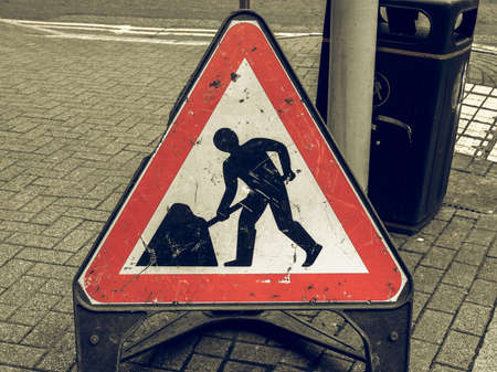 Vintage looking Road works sign for construction works in street