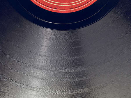 Vintage looking Detail of vintage 78 rpm music record isolated over white with copy space