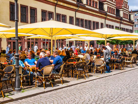 LEIPZIG, GERMANY - JUNE 14, 2014: Tourists in a Biergarten in the city centre in summer (HDR)