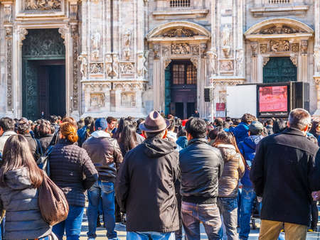 filipino people: MILAN, ITALY - FEBRUARY 23, 2014: People attending mass in front of Milan cathedral celebrated by Filipino Cardinal Luis Antonio Tagle Archbishop of Manila and Antonio Scola Archibishop of Milan (HDR) Editorial