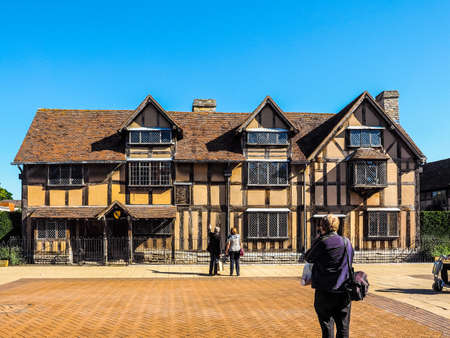william: STRATFORD UPON AVON, UK - SEPTEMBER 26, 2015: Tourists in front of William Shakespeare birthplace (HDR)