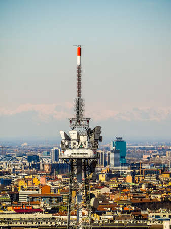 MILAN, ITALY - MARCH 28, 2015: The broadcasting tower of RAI Italian public television seen over the city skyline (HDR) Editorial