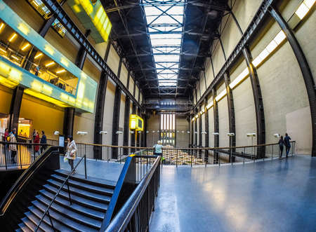 housed: LONDON, UK - SEPTEMBER 28, 2015: The Turbine Hall once housed the electricity generators of the power station now a public space part of Tate Modern art gallery in South Bank seen with fisheye lens (HDR)