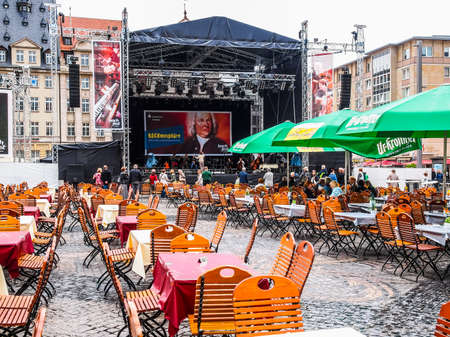 LEIPZIG, GERMANY - JUNE 14, 2014: People in beer garden at the Bachfest annual summer music festival celebrating baroque musician Johann Sebastian Bach in his town (HDR)
