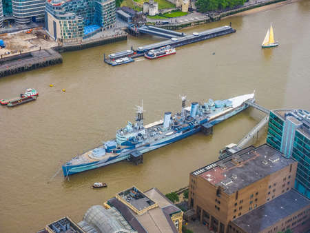 permanently: LONDON, UK - JUNE 10, 2015: HMS Belfast ship originally a Royal Navy light cruiser is now permanently moored on the River Thames as a museum ship (HDR)