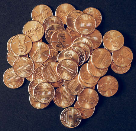 Vintage looking One cent wheat penny coin currency of the United States over black background