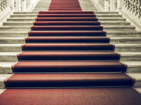 occasions: Vintage looking Red carpet on a stairway used to mark the route taken by heads of state, vips and celebrities on ceremonial and formal occasions or events