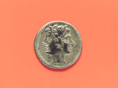 janus: Vintage looking Ancient Roman coin with Janus over red background Stock Photo