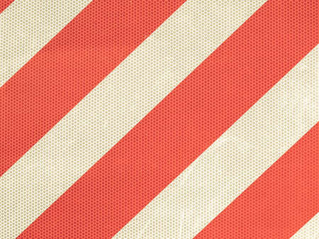 reflective: Vintage looking Reflective red and white stripes on a traffic sign