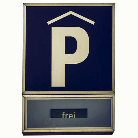 frei: Vintage looking A road sign for a parking area - in German (Deutsch) - isolated over white background Stock Photo