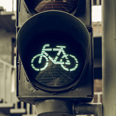 bycicle: Vintage looking Green light for bycicle lane on a traffic light