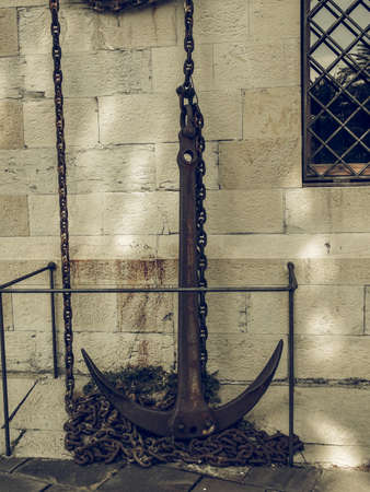 attach: Vintage looking An anchor to attach ships to the bottom of the sea Foto de archivo