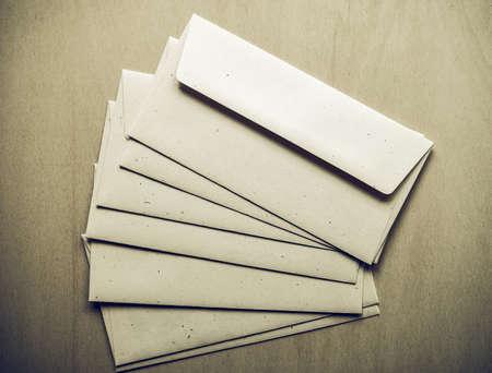 sobres para carta: Vintage looking Letter envelopes for mail postage on wooden table