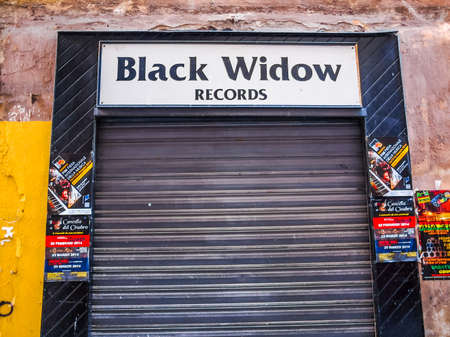 record label: GENOA, ITALY - MARCH 16, 2014: Black Widow Records in Via del Campo is a small Italian record label specialising in rare and obscure prog and goth acts (HDR)