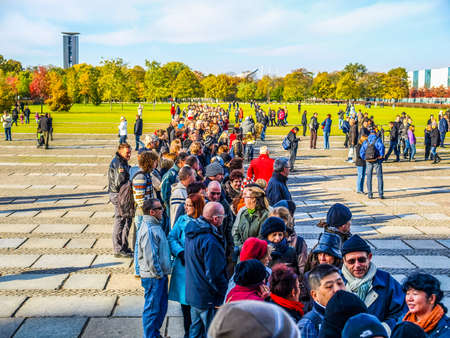 queueing: BERLIN, GERMANY - OCTOBER 23: People queueing to visit the Reichstag (The German Parliament) in Berlin Germany on October 23, 2010 in Berlin, Germany (HDR)