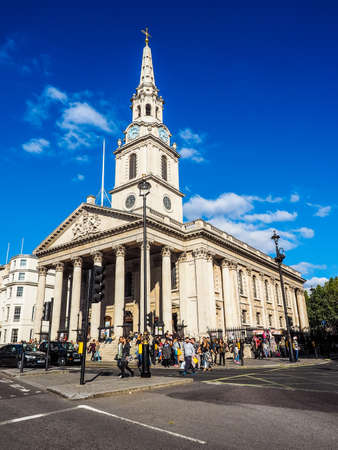 LONDON, UK - SEPTEMBER 27, 2015: Tourists in Trafalgar Square in front of St Martin in the Fields church (HDR)