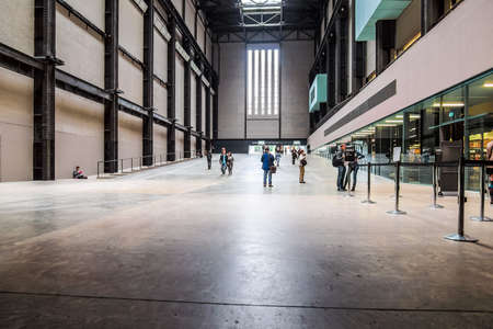 housed: LONDON, UK - CIRCA JUNE, 2011: Tourists visiting the Turbine Hall which once housed the electricity generators of the power station now part of Tate Modern art gallery in South Bank (HDR)