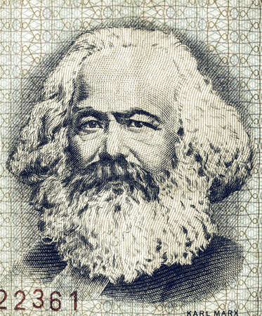 ddr: Vintage looking Portrait of Karl Marx on an East German banknote - money no more in use since the reunification of germany in 1991 Editorial
