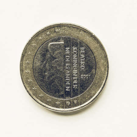 nederland: Vintage looking Currency of Europe 1 Euro coin from Netherlands