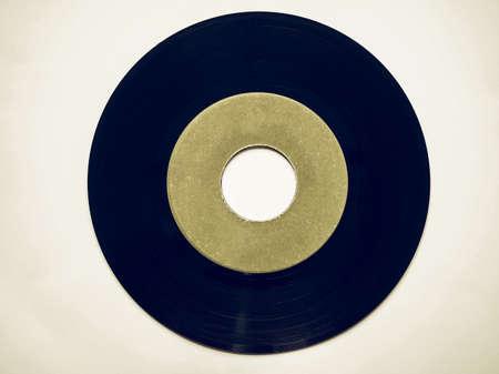 rpm: Vintage looking Single vinyl record vintage analog music recording medium 45 rpm green label