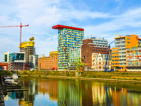 DUESSELDORF, GERMANY - AUGUST 3, 2009: The new Medienafen is a redevelopment area in the former docklands and harbour with buildings designed by Steven Holl, David Chipperfield and Frank O Gehry (HDR) Editorial
