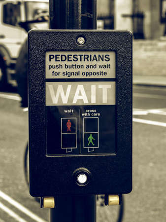 wait sign: Vintage looking Wait sign at a traffic light for pedestrian crossing Stock Photo