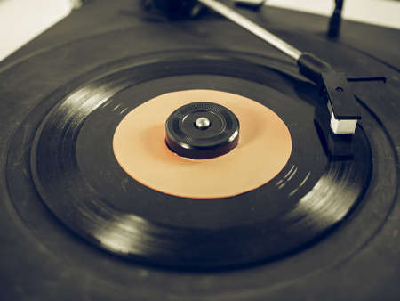 record player: Vintage looking Vinyl record on a turntable record player, single 45rpm disc Stock Photo