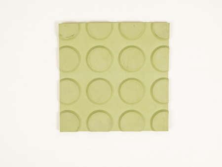 tiling: Vintage looking Sample of green rubber linoleum material used for floor tiling