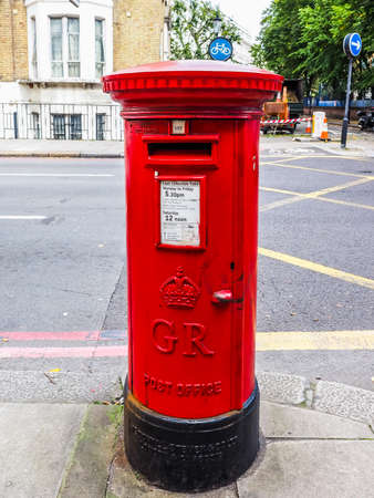 royal mail: LONDON, UK - SEPTEMBER 27, 2015: Royal Mail mailbox for mail collection (HDR)