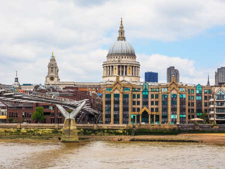 LONDON, UK - JUNE 10, 2015: People crossing the Millennium Bridge linking the City of London with the South Bank between St Paul Cathedral and Tate Modern art gallery (HDR) Editorial
