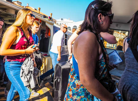 waterbus: VENICE, ITALY - CIRCA SEPTEMBER 2016: HDR Travellers on a vaporetto (meaning waterbus) public transport