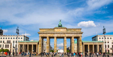 brandenburg gate: BERLIN, GERMANY - MAY 09, 2014: Tourists visiting the Brandenburger Tor (Brandenburg Gate) linking East and West Berlin (HDR)