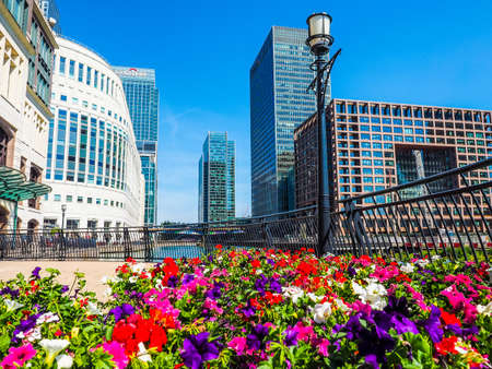 largest: LONDON, UK - JUNE 11, 2015: The Canary Wharf business centre is the largest business district in the United Kingdom (HDR)
