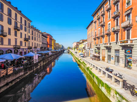 MILAN, ITALY - MARCH 28, 2015: Tourists at the Naviglio Grande canal waterway in Milan Italy (HDR)