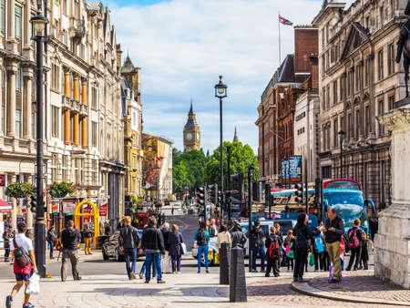 trafalgar: LONDON, UK - JUNE 09, 2015: Tourists visiting Trafalgar Square (HDR)