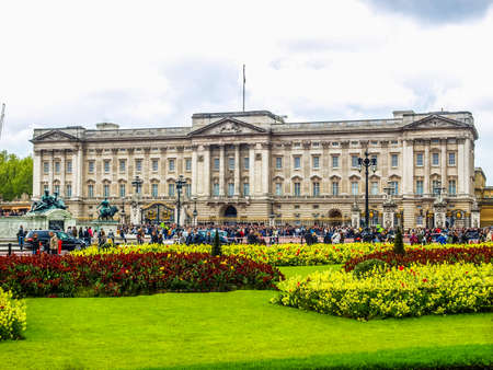 hm: LONDON, ENGLAND, UK - MAY 08, 2010: Tourists visiting Buckingham Palace official London residence of the British monarchy where the HM Queen Elizabeth II lives with her husband Prince Philip (HDR) Editorial