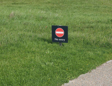 no entry: No entry sign in a meadow amidst the grass