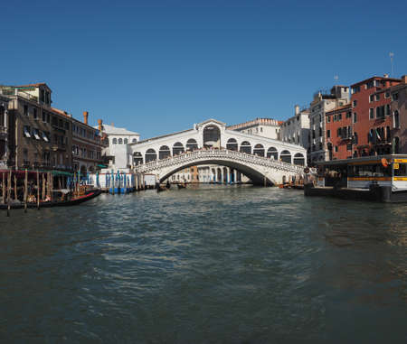 grand canal: VENICE, ITALY - CIRCA SEPTEMBER 2016: Ponte di Rialto (meaning Rialto Bridge) over the Grand Canal Editorial